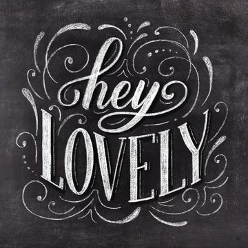 Hey lovey hand drawn chalk lettering on chalkboard background. Valentine's Day holiday vintage illustration.