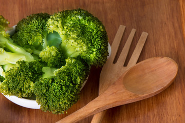 Green broccoli cooked with salt and wooden cutlery