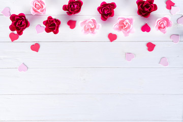 Rose shape of soap and red hearts on wooden white background for text for valentine's day