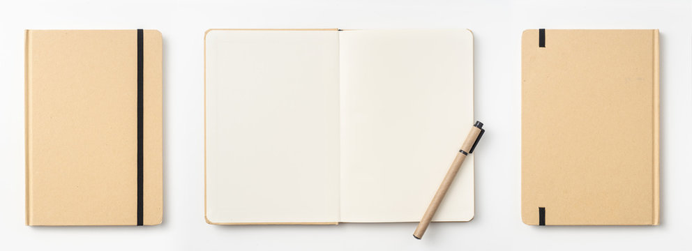 Top view of kraft paper notebook, page, pencil