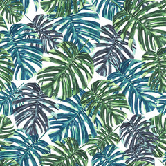Seamless tropical monstera leaves and flowers pattern, jungle print design. Pattern on white background. Fashion trended tropical background.