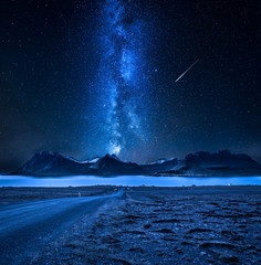 Mountain peaks, fjords and milky way in Iceland at night