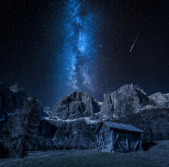 Stunning milky way over valley in Dolomites, Italy