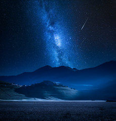 Wonderful milky way over Castelluccio at night, Umbria, Italy, Europe