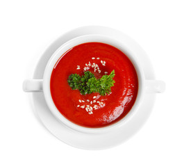 Dish with fresh homemade tomato soup on white background, top view