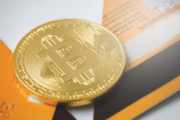 Bitcoin and broken credit card on white background