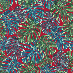 Seamless tropical monstera leaves and flowers pattern, jungle print design. Pattern on red background. Fashion trended tropical background.