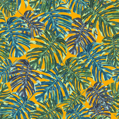 Seamless tropical monstera leaves and flowers pattern, jungle print design. Pattern on orange background. Fashion trended tropical background.