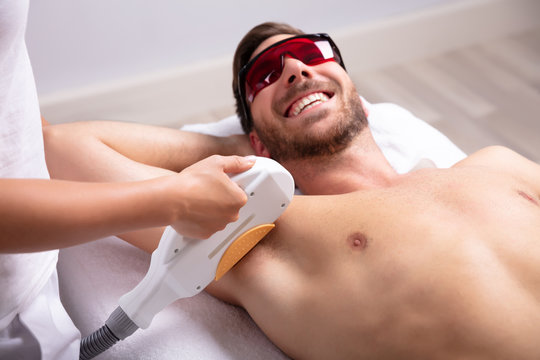 Young Man Having Underarm Laser Hair Removal Treatment