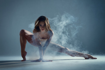 Dancing in cloud concept. Muscle brunette beauty female girl adult woman dancer athlete in fog...