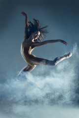 Dancing in cloud concept. Muscle brunette beauty female girl adult woman dancer athlete gymnast in...