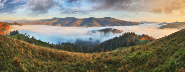 picturesque sunrise in the Carpathian mountains. autumn foggy morning
