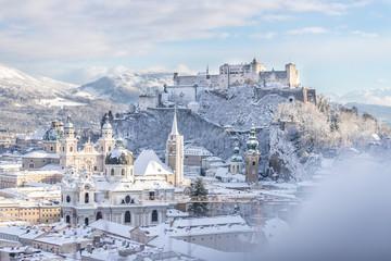 Panorama of Salzburg in winter: Snowy historical center, sunshine