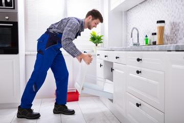 Handyman Installing Drawer In Kitchen