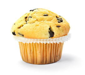 Delicious vanilla muffin with chocolate, isolated on white background. Muffin and paper, sweet food or unhealthy eating theme.