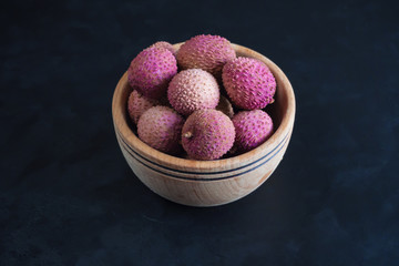 Ripe lychees on a black table.