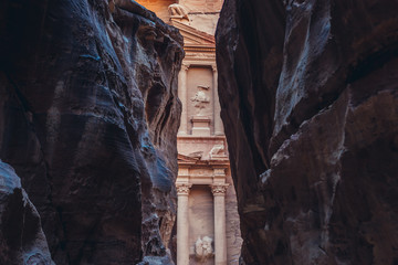 The Treasury building in ancient city of Petra in Jordan, view from Siq valley