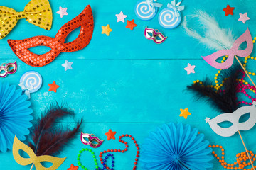 Carnival or mardi gras background with carnival masks, beards and photo booth props.