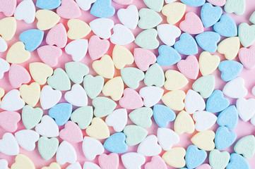 top down view of a bunch of valentine candy hearts