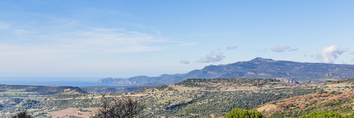 Panorama  with a view on the mountains and the sea in Northers East Sardinia, Italy