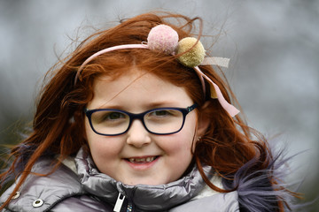 Sophie Ni Lainn, aged 7, poses for a photograph to celebrate 'Kiss a Ginger Day' on the 10-year anniversary of this anti-bullying day, in Dublin