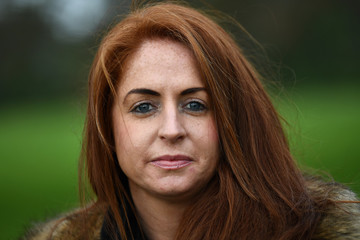 Sarah Ennis, aged 34, poses for a photograph to celebrate 'Kiss a Ginger Day' on the 10-year anniversary of this anti-bullying day, in Dublin
