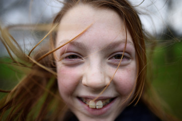 Catherine Steward, aged 11, poses for a photograph to celebrate 'Kiss a Ginger Day' on the 10-year anniversary of this anti-bullying day, in Dublin
