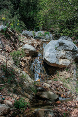 a small waterfall with clean drinking water in the rocks. natural background