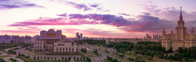 Wide angle panoramic view of sunset evening campus of famous Russian university under dramatic sky in Moscow