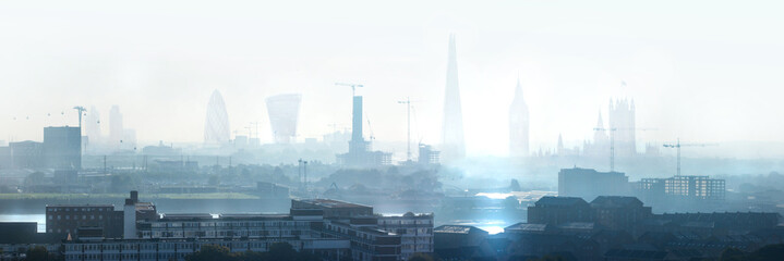 London view the morning. Panorama include river Thames, Big Ben and houses of Parliament, City of London buildings in the early morning mist.