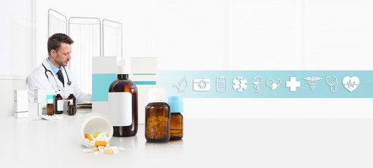 doctor at desk office with pills, drugs and medicine bottles, internet healthcare and medical symbols icons, web banner and copy space template