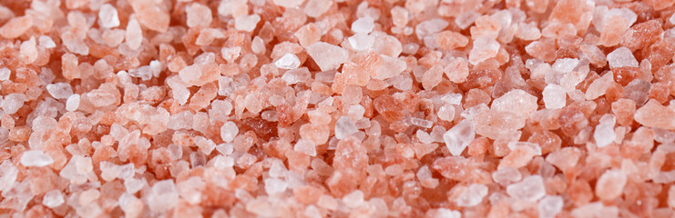 Pink himalayan salt isolated on white background.