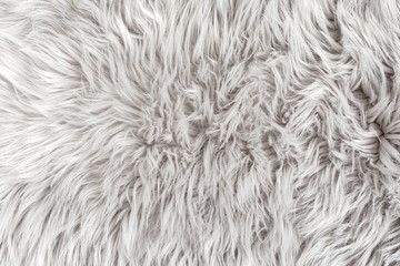 White fur for background or texture. Fuzzy white fur plaid. Shaggy blanket background. Fluffy fake textile fur. Flat lay, top view, copy space  Wall mural