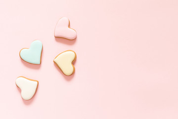 Composition Valentine's Day. Ginger cookie in shape heart on pastel pink background. Valentine day concept, design.