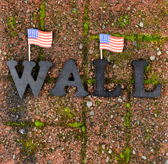 Red grunge brick with metal letters and United States flags for border wall protection concept
