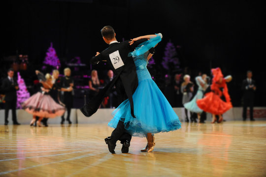 young couple athletes dancers competition in ballroom dancing