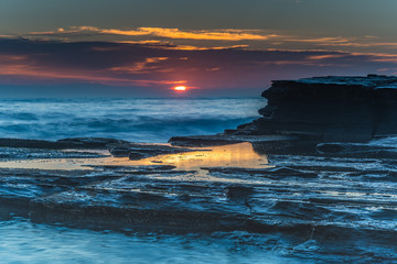Dramatic Sunrise Seascape over the Rock Ledge