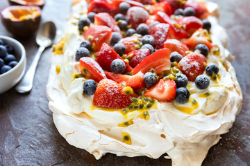 Pavlova Meringue Cake with Berries and Passionfruit Top View