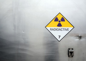 Radiation warning sign on the Dangerous goods transport label Class 7 at the container of transport truck