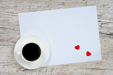 valentine's day greeting card, coffee cup and heart shapes on white wooden planks