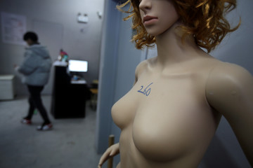 A plastic mannequin with a price sign is placed next to the door of an anger room in Beijing