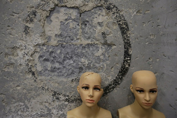 Destroyed mannequins are placed at the corner of a wall in an anger room in Beijing