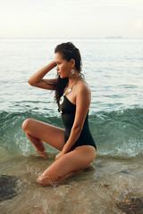 Summer Fashion. Sexy Asian Woman In Swimsuit On Beach