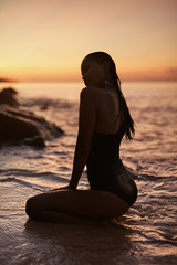 Summer. Woman With Sexy Body In Sea With Sunset On Background