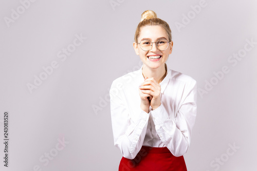 08bbe106d ... blonde business woman wearing round eyeglasses, white cotton blouse top  & sexy tight red skirt. Gray isolated background, copy space, close up,  portrait
