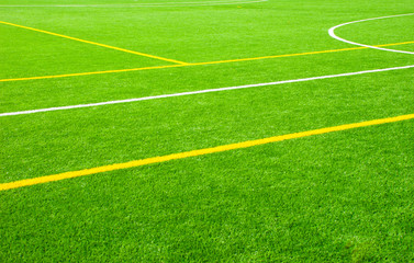 Football field green background with white and yellow line. Sport texture.