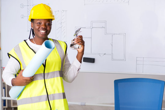 Young black architect working on project