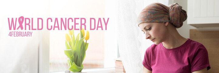 World Cancer Day Banner. Young adult female cancer patient wearing headscarf sitting by a window, with her head down.