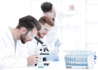 toned image.a group of scientists conduct research
