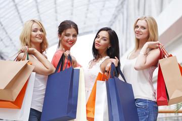 Happy women shopping in mall